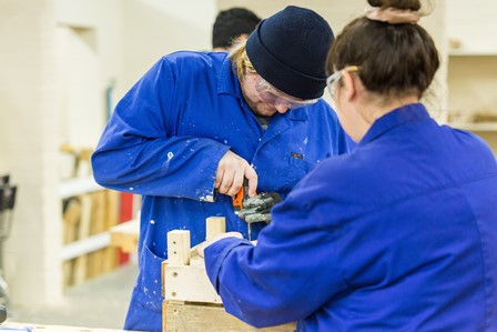 QAC student and staff member build a wooden box in Trades workshop