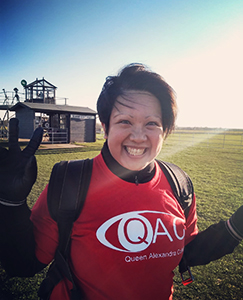 A Lady pictured before taking on a fundraising challenge in support of QAC