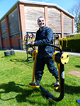 A student enjoying using the new College outdoor gym